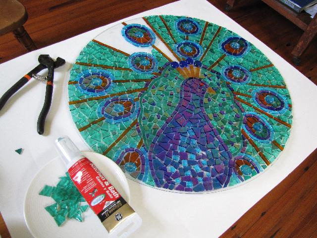 working on peacock mosaic